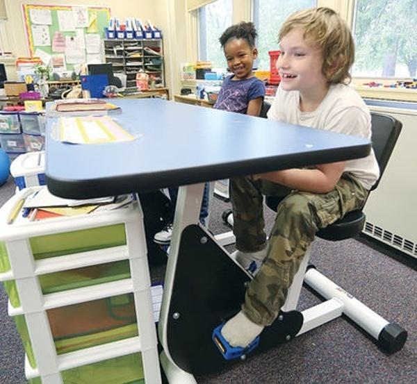 Boy on Pedal Desk (1).jpg